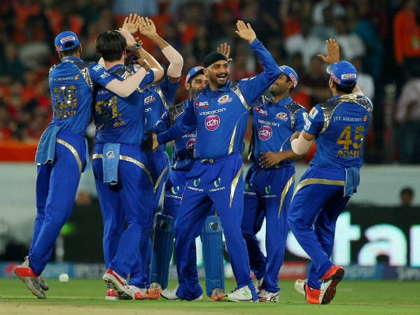 MI players celebrate the wicket of Eoin Morgan