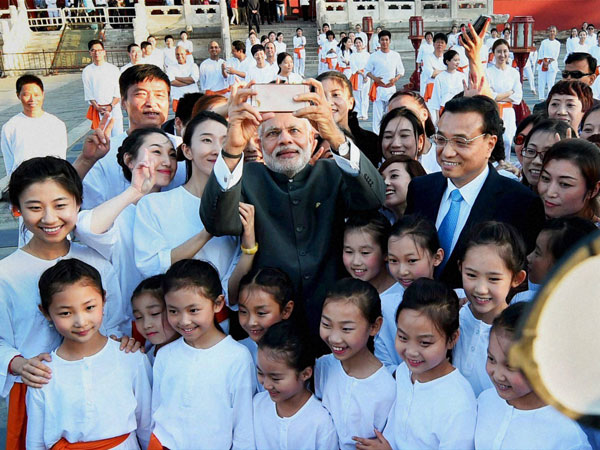 Modi smiles for the camera with Chinese Tai Chi students