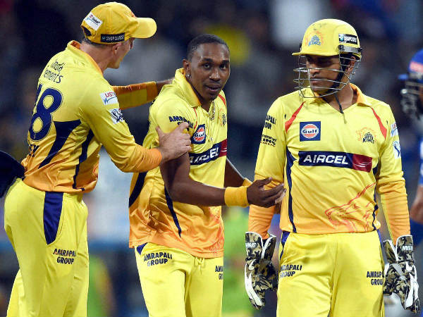 Hussey, Bravo and Dhoni celebrate the dismissal of Parthiv