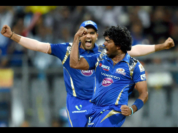 Malinga and Rohit celebrate the wicket of Smith