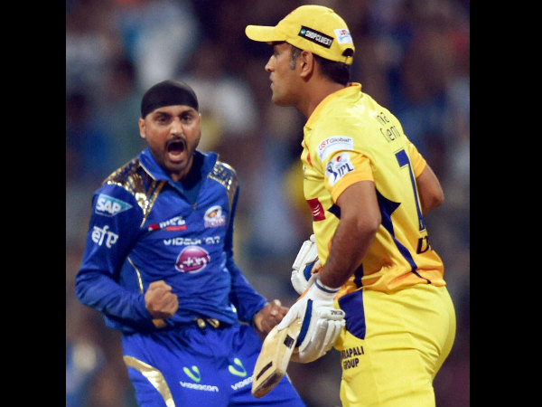 Harbhajan (left) celebrates after dismissing Dhoni for a golden duck
