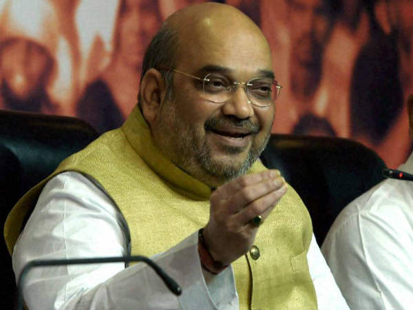 Manmohan made same number of foreign trips as Modi, says Amit Shah.