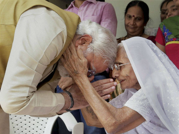 Modi being blessed by his mother