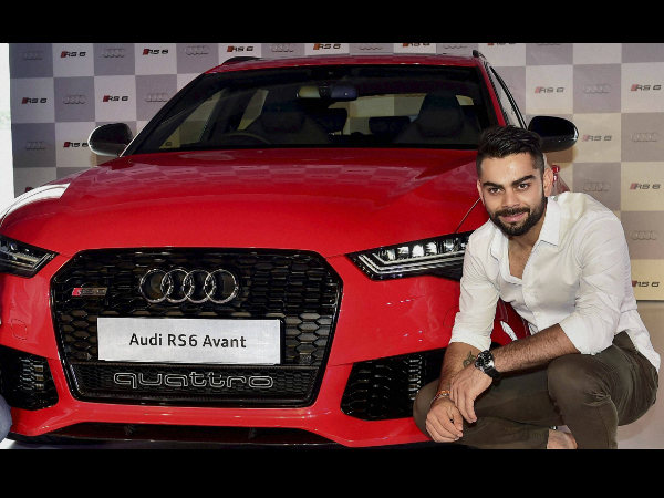 Virat Kohli poses with Audi RS6 Avant in New Delhi on Thursday after the launch event.
