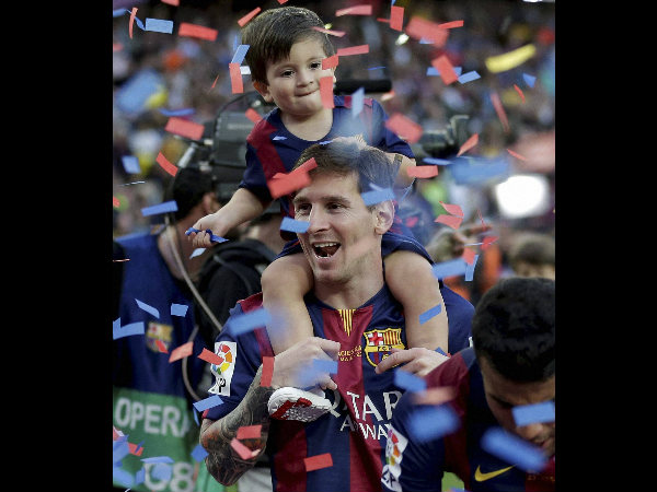 Lionel Messi has a chance to set a record. He is seen here celebrating with his son after winning La Liga title this year