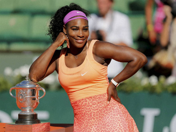Serena Williams poses with her trophy