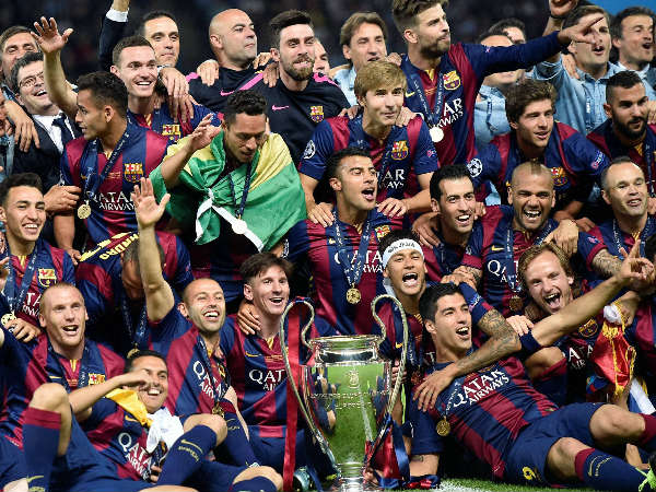 Barcelona players celebrate with the trophy