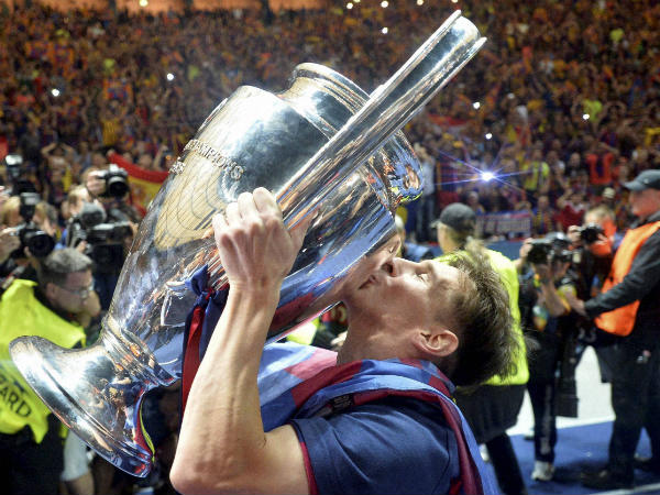 Lionel Messi kisses the trophy
