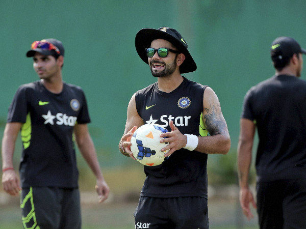 India's Test captain Virat Kohli (centre) during a training session
