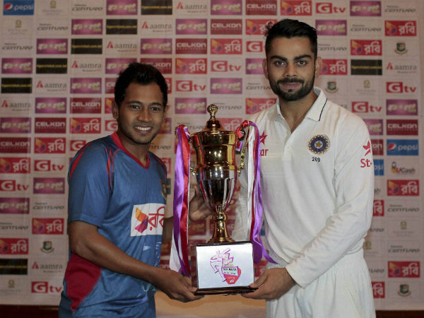 Trophy was shared. Seen here are the captains Mushfiqur Rahim (left) and Virat Kohli