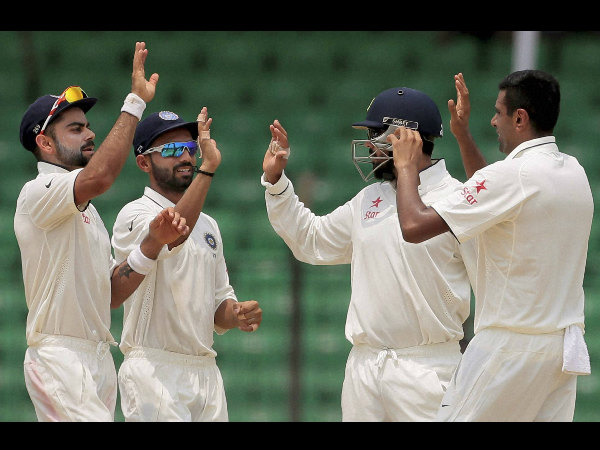 Ashwin (right) celebrates with team-mates after taking Shakib Al Hasan's wicket