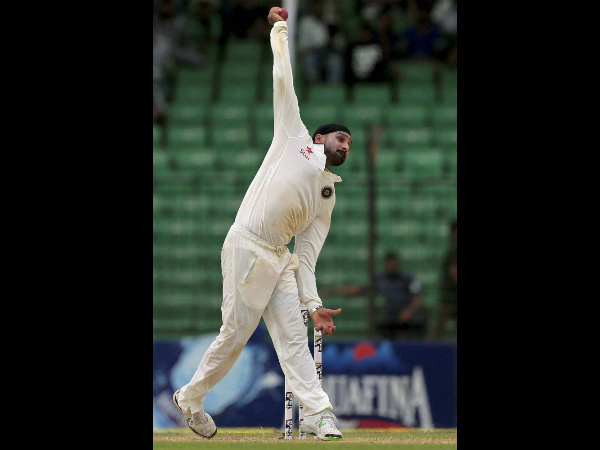 Harbhajan Singh bowls on the final day of the Test