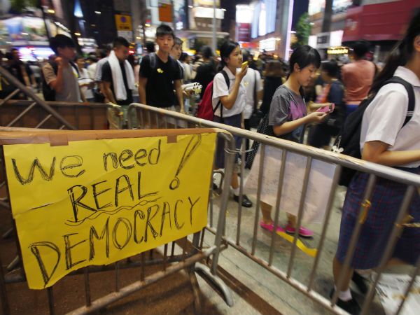 Hong Kong rejects China-backed poll plan