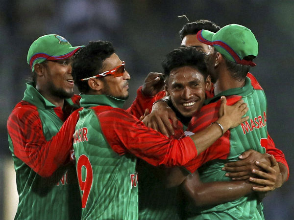 Mustafizur Rahman (centre), celebrates a wicket with team-mates