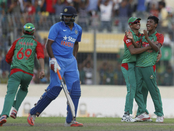Mustafizur Rahman, right, celebrates with his teammate Taskin Ahmed, second right, after the dismissal of R Ashwin, second left