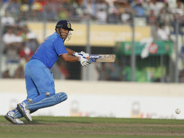 MS Dhoni plays a shot against Bangladesh during the 1st ODI