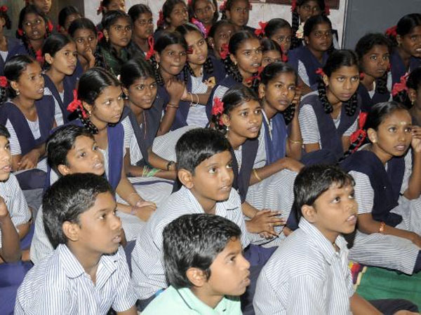 Narendra Modi urged to ensure compulsory teaching of three languages.