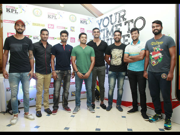 Karnataka captain R Vinay Kumar (3rd left) along with other players pose for photographers at the launch event