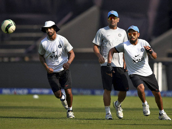 Dhoni (centre) and Kohli (right) play football with Shikhar Dhawan during Team India's training session
