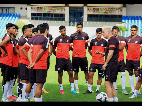 Coach Stephen Constantine talks to Indian players at the Sree Kanteerava Stadium in Bengaluru on Tuesday.