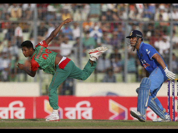 Mustafizur Rahman bowls during the 2nd ODI as MS Dhoni watches