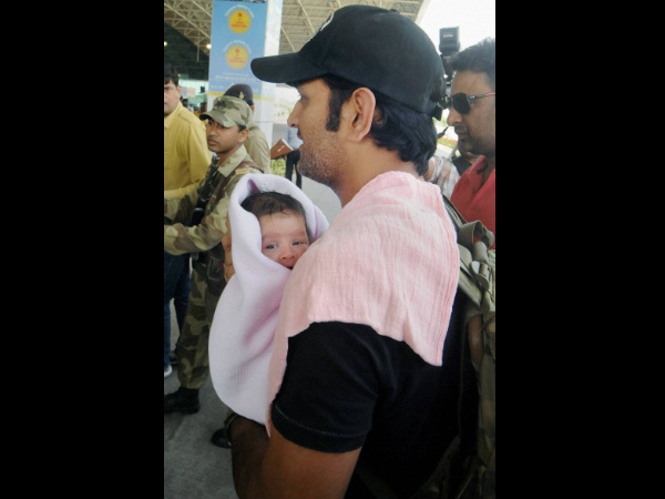 Dhoni with his daughter Ziva