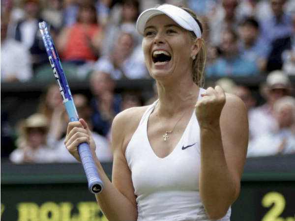 Maria Sharapova of Russia celebrates winning the singles match against Coco Vandeweghe of the United States