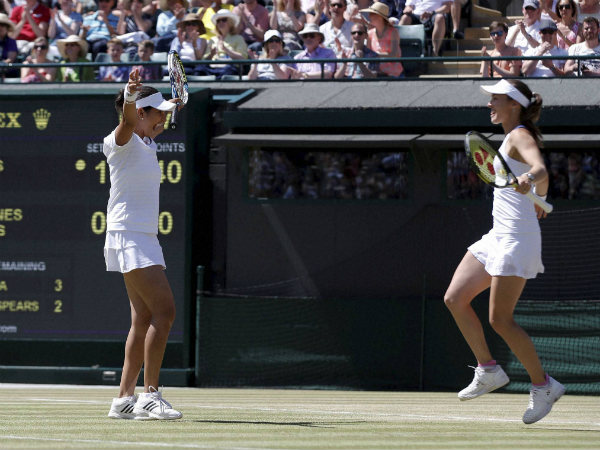 Sania (left) and Martina celebrate their win