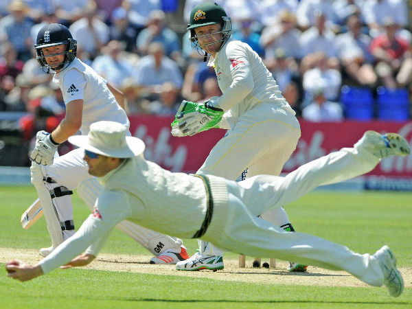 Brilliant catch - Adam Lyth, left, is caught Michael Clarke, foreground, for 37 runs off the bowling Australia's Nathan Lyon during day three