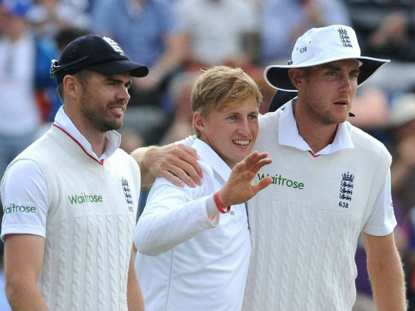 Joe Root, centre, celebrates with Stuart Broad, right, and James Anderson after taking Mitchell Starc's wicket