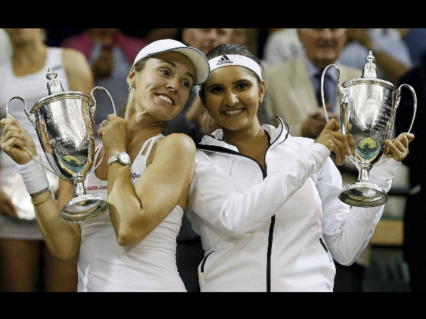 Sania (right) and Martina with their trophies