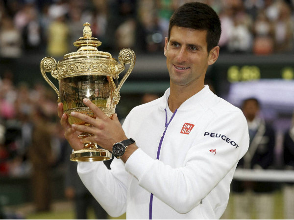 Novak Djokovic poses with his trophy