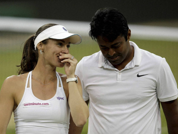 Hingis and Paes talk during their final match at Wimbledon