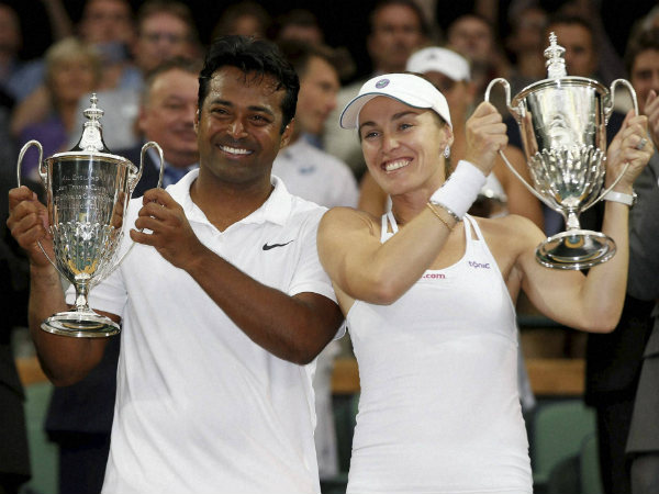 Paes (left) and Hingis celebrate with their trophies