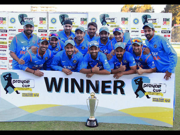 Indian players pose with the trophy after winning 3-0 against Zimbabwe