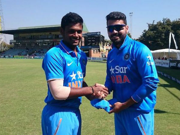 Samson receives his India cap from Vijay. Photo from BCCI's Twitter page