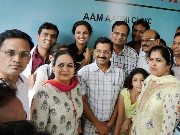 Delhi Chief Minister Arvind Kejriwal pose for photographs during the inauguration the first 'Aam Aadmi Clinic' in New Delhi on on Sunday. Delhi government will open 1000 such clinics this year in the city.