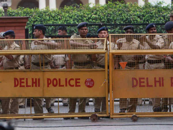 AAP supporters protesting against Delhi Police cane-charged.