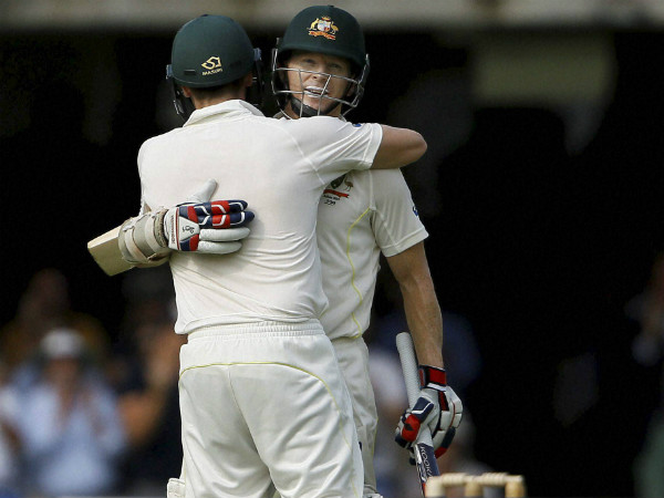 Rogers (facing camera) hugs Steve Smith after completing century in 2nd Ashes Test