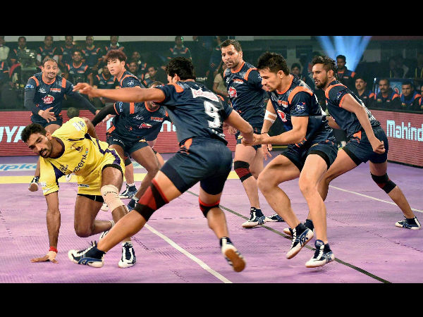 Bengal Warriors (blue) and Telugu Titans' players in action during their Pro Kabaddi match in Kolkata on Thursday.