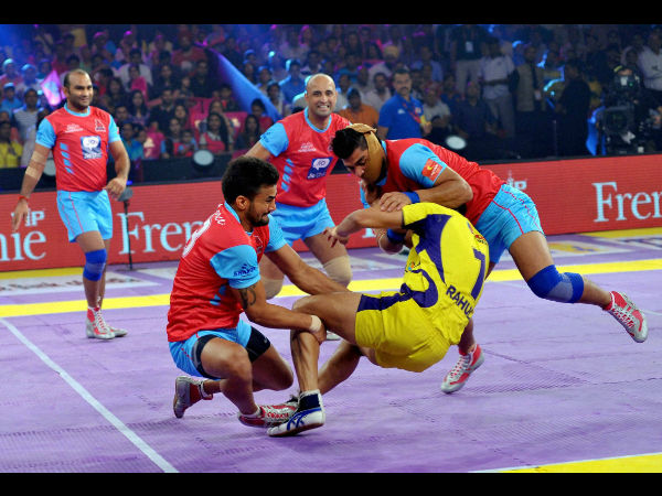 Players of Jaipur Pink Panthers (red and blue) and Telugu Titans in action during the Pro Kabaddi League match at Sawai Mansingh Stadium in Jaipur on Monday