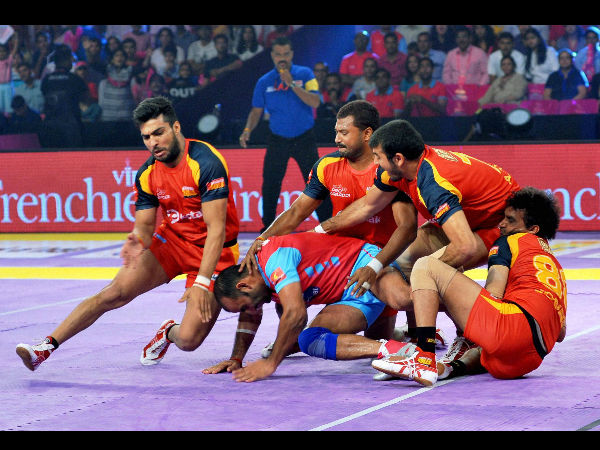 Players of Jaipur Pink Panthers and Bengaluru Bulls (red, yellow and black) in action during the Pro Kabaddi league match at Sawai Mansingh Stadium in Jaipur on Tuesday