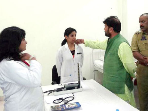 BJP min touches woman doctor's collar
