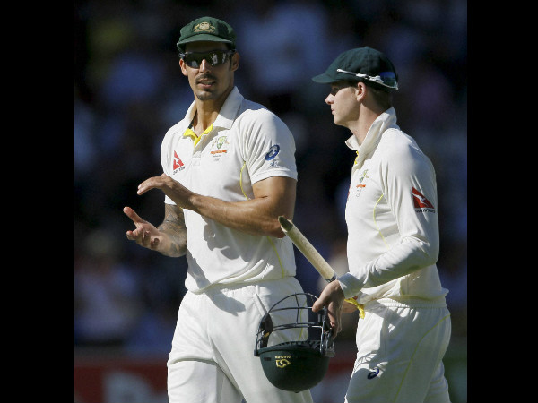 Mitchell Johnson (left) with Steve Smith during the 1st Ashes Test