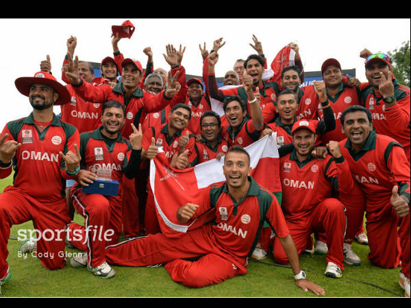 Omani players celebrate after the win. Photo: ©ICC/Sportsfile