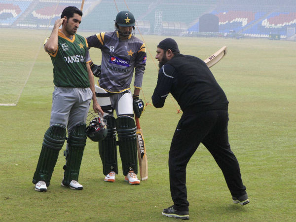 A file picture of Inzamam (right) giving batting tips