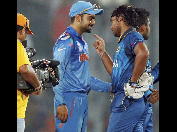 File photo: Sangakkara (right) talks to Kohli (centre) after the World T20 final in 2014. Sri Lanka won the trophy defeating India in Dhaka