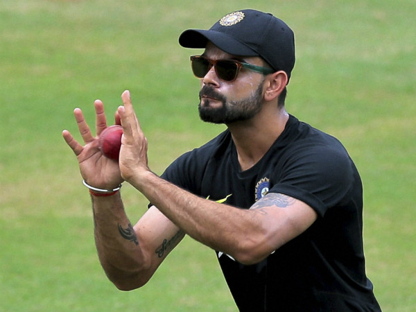Kohli takes a catch during practice in Colombo on Wednesday (August 5)