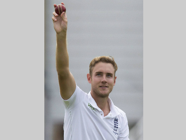 Broad raises the ball after taking his 5th wicket