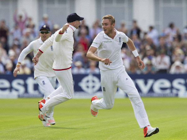 Stuart Broad, right, celebrates taking the wicket of Steve Smith